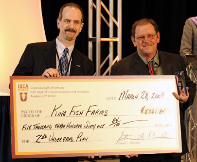 Paul Boisvert, left, with the Kentucky Cabinet for Economic Development and coordinator for Idea State U, presents the second-place prize to Everett King, Waco, for his business plan for King Fish Farms.